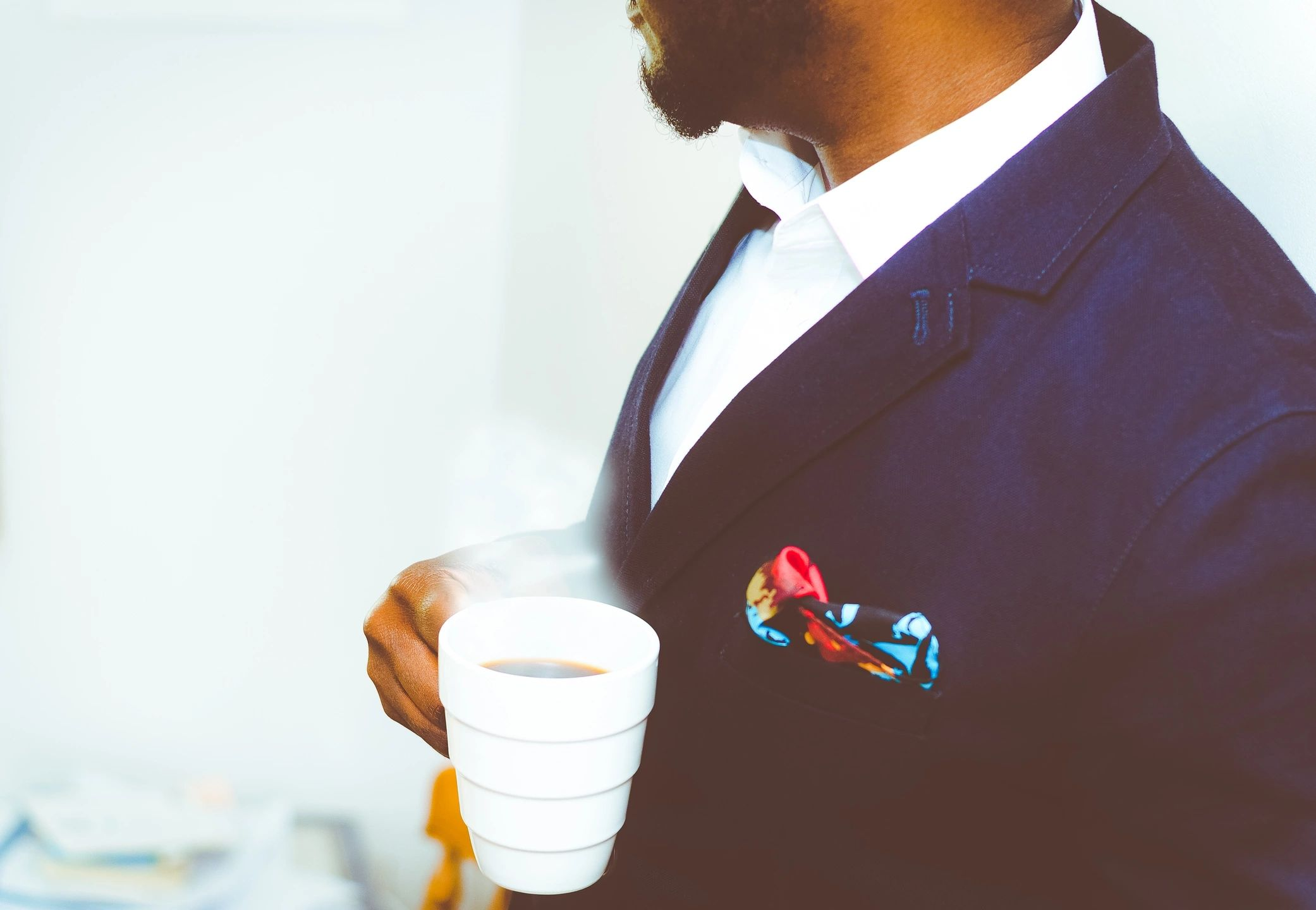 Business leader drinking coffee
